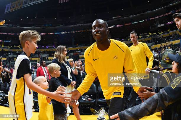 Andre Ingram of the Los Angeles Lakers high fives fans before the game against the Houston Rockets on April 10 2017 at STAPLES Center in Los Angeles...