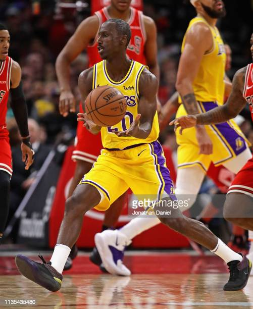 Andre Ingram of the Los Angeles Lakers passes the ball against the Chicago Bulls at the United Center on March 12 2019 in Chicago Illinois The Lakers...