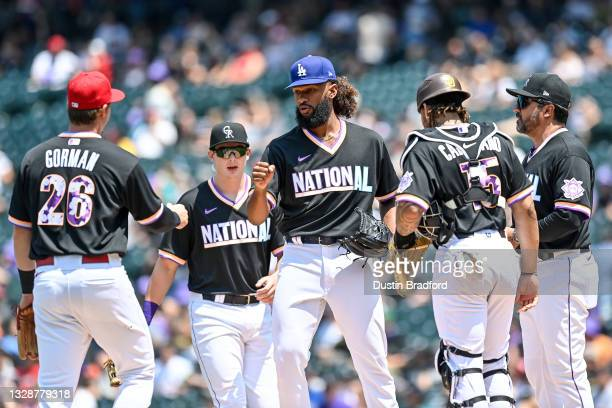 Andre Jackson of the National League Futures Team is congratulated by teammates including Nolan Gorman, Michael Toglia, and Luis Campusano as he is...