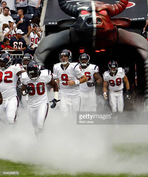 Andre Johnson and Matt Leinart are introduced to the crowd before playing the Indianapolis Colt during the NFL season opener at Reliant Stadium on...