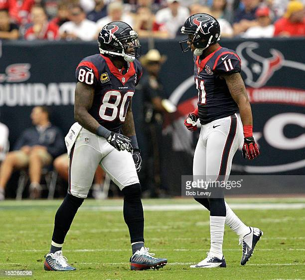 Andre Johnson of the Houston Texans and DeVier Posey of the Houston Texans during action against the Tennessee Titans at Reliant Arena at Reliant...