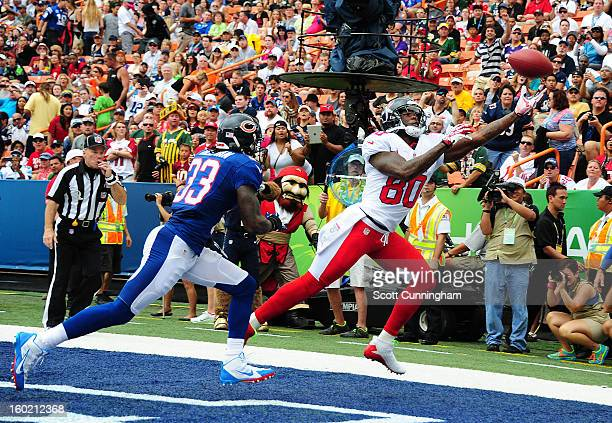 Andre Johnson of the Houston Texans and the AFC goes up for a pass against Charles Tillman of the National Football Conference team during the 2013...