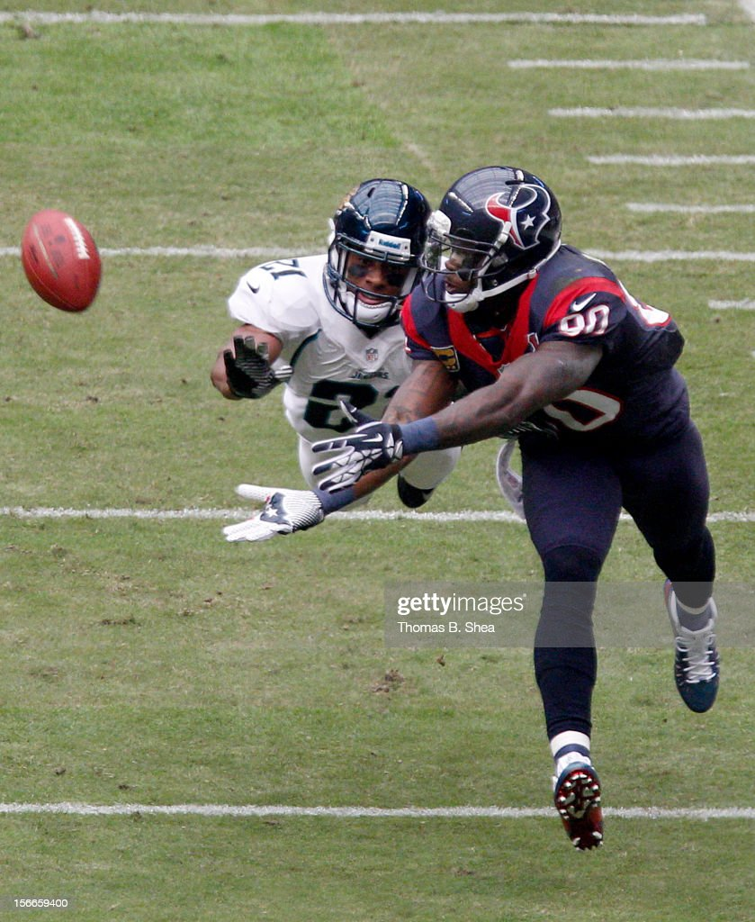 Andre Johnson #80 of the Houston Texans can't quite make the catch while Derek Cox #21 of the Jacksonville Jaguars covers on the play on November 18, 2012 at Reliant Stadium in Houston, Texas.