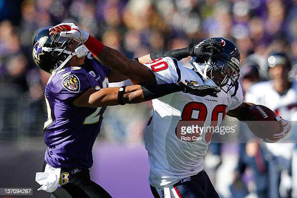 Andre Johnson of the Houston Texans fights to maintain possession of the ball against Cary Williams of the Baltimore Ravens during the first quarter...