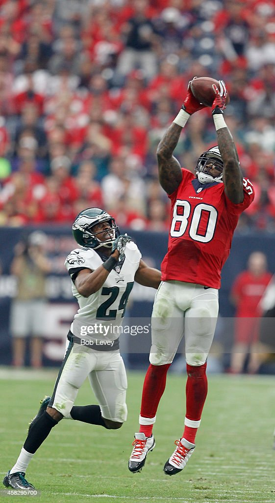 Andre Johnson #80 of the Houston Texans goes up for a pass in front of Bradley Fletcher at Reliant Stadium on November 2, 2014 in Houston, Texas.