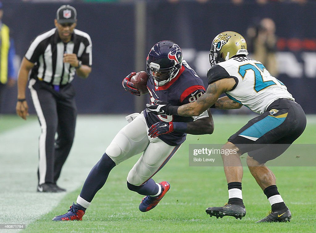 Andre Johnson #80 of the Houston Texans is tackled by Dwayne Gratz #27 of the Jacksonville Jaguars in the first quarter in a NFL game on December 28, 2014 at NRG Stadium in Houston, Texas.