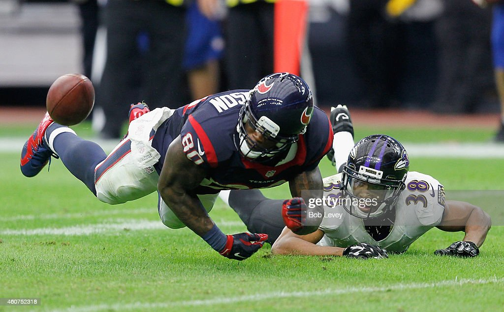 Andre Johnson #80 of the Houston Texans is unable to hold onto the ball as he his defended by Rashaan Melvin #38 of the Baltimore Ravens at NRG Stadium on December 21, 2014 in Houston, Texas.