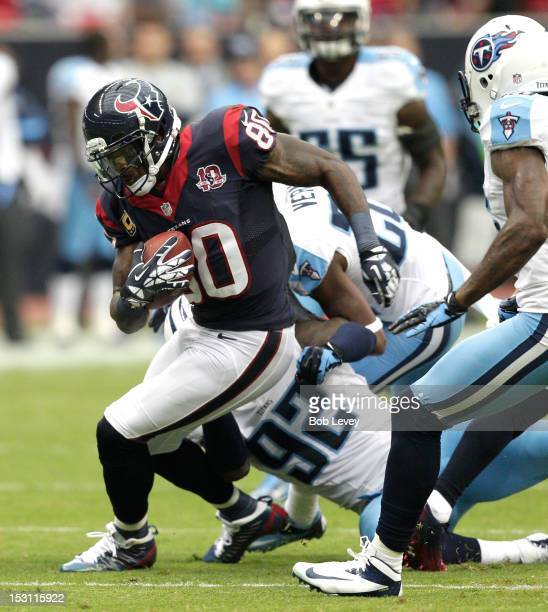 Andre Johnson of the Houston Texans runs with the ball after completing a pass against the Tennessee Titans at Reliant Arena at Reliant Park on...