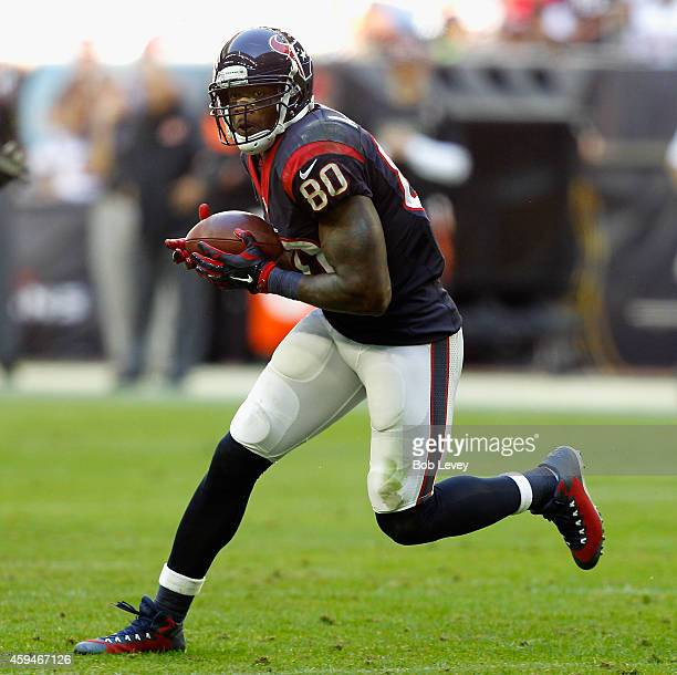 Andre Johnson of the Houston Texans runs with the ball after a reception against the Cincinnati Bengals at NRG Stadium on November 23 2014 in Houston...