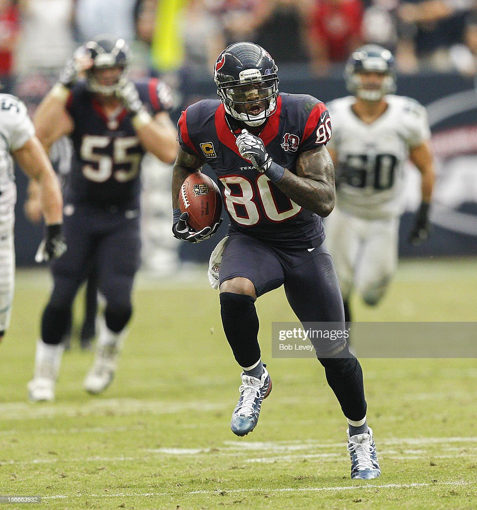 Andre Johnson #80 of the Houston Texans scores on a 48 yard reception in overtime against the Jacksonville Jaguars at Reliant Stadium on November 18, 2012 in Houston, Texas. Houston won 43-37 in overtime.