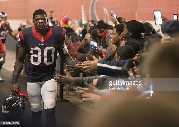 Andre Johnson of the Houston Texans shakes hands with fans before playing the Jacksonville Jaguars in a NFL game on December 28 2014 at NRG Stadium...