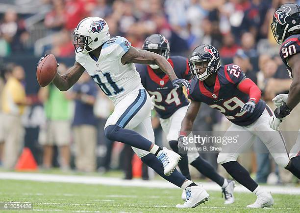 Andre Johnson of the Tennessee Titans runs after getting pitched the ball agains the Houston Texans in the fourth quarter at NRG Stadium on October 2...