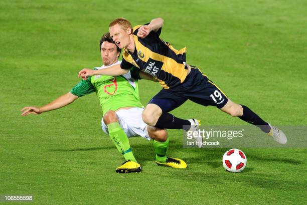 Andre Kilian of the Fury tackles Matt Simon of the Mariners during the round 13 ALeague match between the North Queensland Fury and the Central Coast...