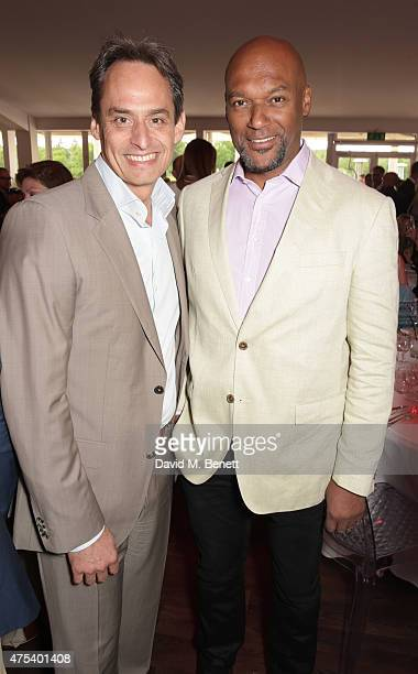 Andre Konsbruck Director of Audi UK and Colin Salmon attend day two of the Audi Polo Challenge at Coworth Park on May 31 2015 in London England