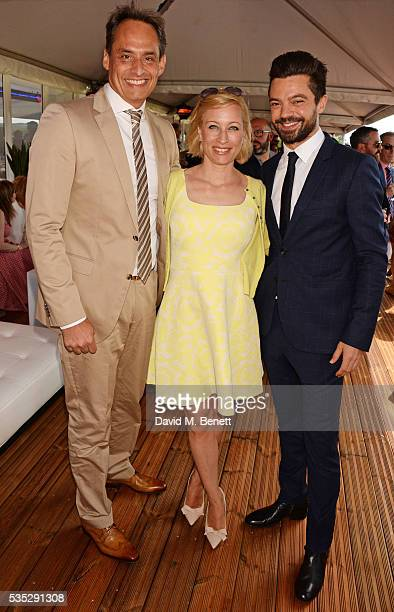 Andre Konsbruck Director of Audi UK Christine Sieg and Dominic Cooper attend day two of the Audi Polo Challenge at Coworth Park on May 29 2016 in...