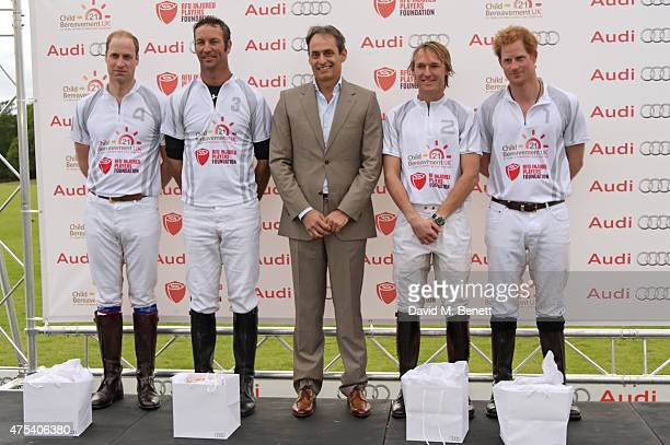 Andre Konsbruck Director of Audi UK poses with Team Ultra players Prince William Duke of Cambridge John Paul Clarkin Mark Tomlinson and Prince Harry...