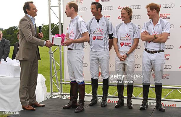 Andre Konsbruck Director of Audi UK presents a gift to Prince William Duke of Cambridge for his new daughter Princess Charlotte of Cambridge as...