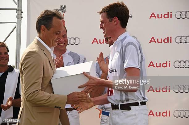 Andre Konsbruck Director of Audi UK Prince William Duke of Cambridge and Ben Vestey attend the Audi Polo Challenge 2015 at Cambridge County Polo Club...