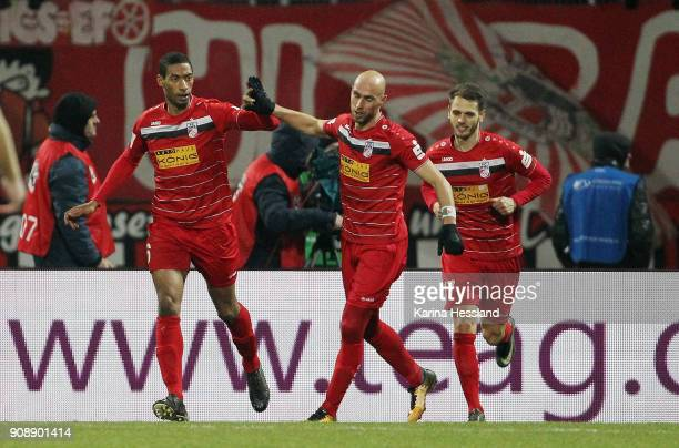 Andre Laurito celebrates the third goal with Daniel Brueckner and Luka Marino Odak of Erfurt during the 3Liga match between FC Rot Weiss Erfurt and...