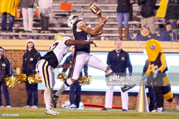 Andre Levrone of the Virginia Cavaliers catches a touchdown pass over Lance Austin of the Georgia Tech Yellow Jackets in the fourth quarter during a...
