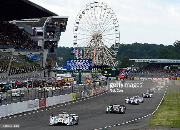 Andre Lotterer of Germany and driver of the Audi R18 etron quattro takes the green flag and leads the field at the start of the 80th running of the...