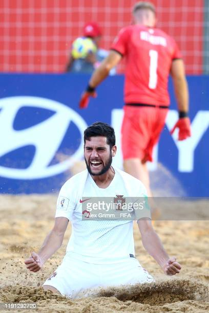 Andre Lourenco of Portugal celebrates after scoring his team's third goal during the FIFA Beach Soccer World Cup Paraguay 2019 Final Match between...
