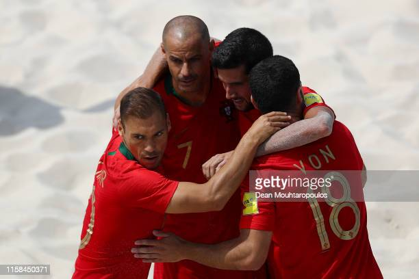 Andre Lourenco of Portugal celebrates scoring a goal with team mates during the Beach Soccer or Fooball Men's First Round group A match between...