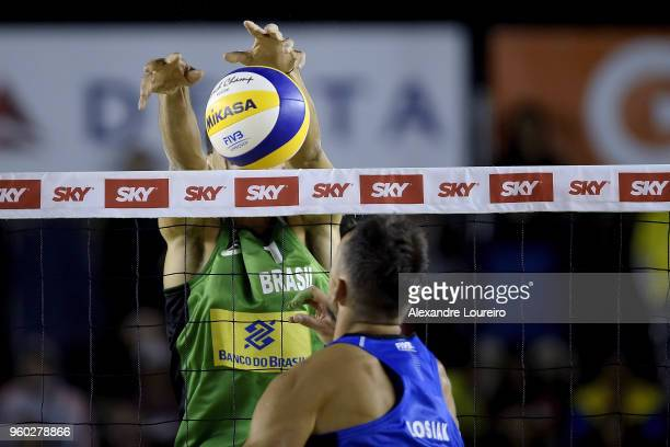 Andre Loyola Stein of Brazil in action during the main draw semifinals match against Piotr Kantor and Bartosz Losiak of Poland at Meia Praia Beach...