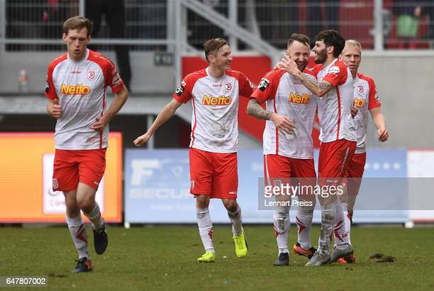 Andre Luge of Jahn Regensburg and his teammates celebrate their side's second goal during the 3 Liga match between Jahn Regensburg and Sportfreunde...