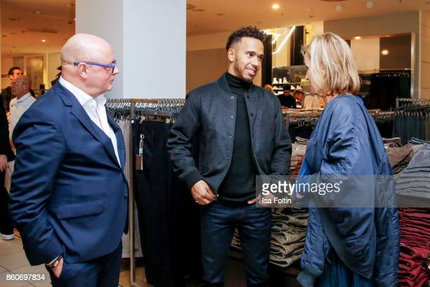 Andre Maeder and formular 1 race driver Lewis Hamilton and Petra Fladenhofer during the KaDeWe X Hugo Boss Evening with Lewis Hamilton on October 12...