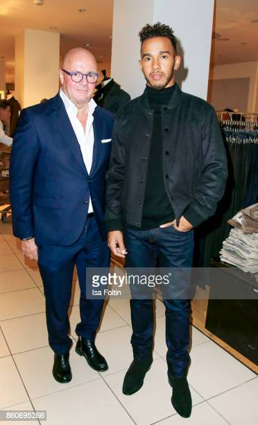 Andre Maeder and formular 1 race driver Lewis Hamilton during the KaDeWe X Hugo Boss Evening with Lewis Hamilton on October 12 2017 in Berlin Germany