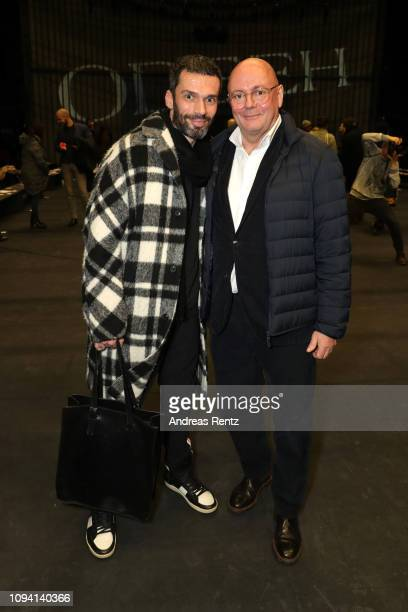 Andre Maeder and guest attend the runway at the Odeeh Defile during the Berlin Fashion Week Autumn/Winter 2019 at Haus Der Berliner Festspiele on...