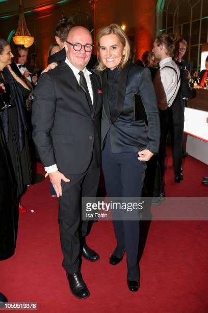 Andre Maeder and Petra Fladenhofer attend the GQ Men of the Year Award after show party at Komische Oper on November 8 2018 in Berlin Germany