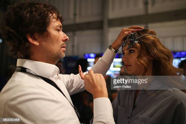 Andre Maertens and Stefanie Giesinger are seen backstage ahead of the Dimitri show during the Mercedes-Benz Fashion Week Berlin Spring/Summer 2016 at...