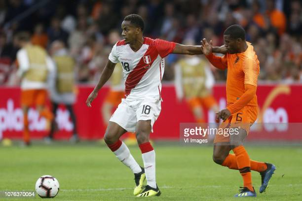 Andre Martin Carillo Diaz of Peru Georginio Wijnaldum of Holland during the International friendly match match between The Netherlands and Peru at...