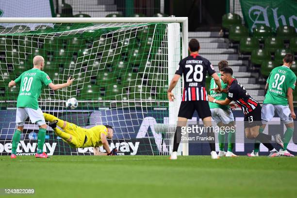 Andre Miguel Valente da Silva of Eintracht Frankfurt scores during the Bundesliga match between SV Werder Bremen and Eintracht Frankfurt at...