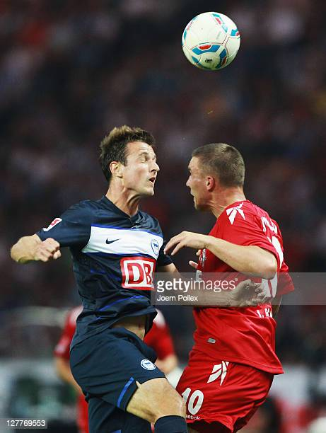 Andre Mijatovic of Berlin and Lukas Podolski of Koeln battle for the ball during the Bundesliga match between Hertha BSC Berlin and 1 FC Koeln at...
