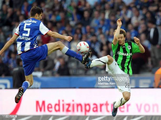 Andre Mijatovic of Berlin battles for the ball with Tarik Camdal of Muenchen during the Second Bundesliga match between Hertha BSC Berlin and TSV...