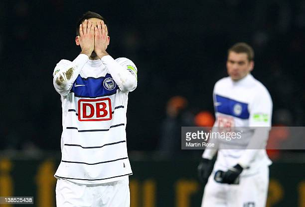 Andre Mijatovic of Berlin looks dejected after the DFB Cup Quarter Final match between Hertha BSC Berlin and Borussia Moenchengladbach at Olympic...