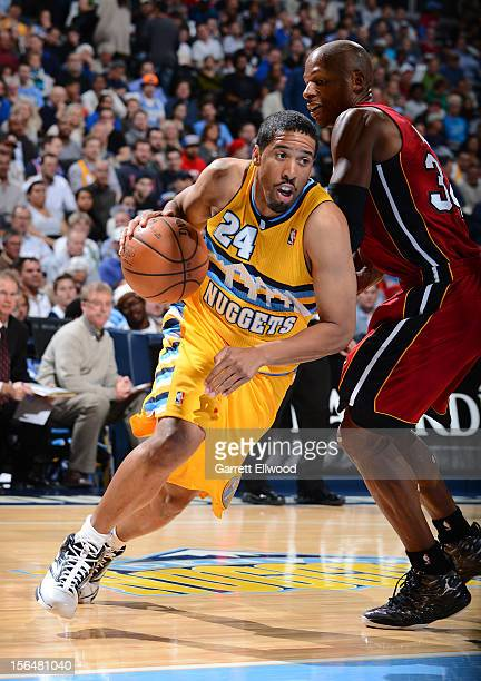 Andre Miller of the Denver Nuggets drives against Ray Allen of the Miami Heat on November 15 2012 at the Pepsi Center in Denver Colorado NOTE TO USER...