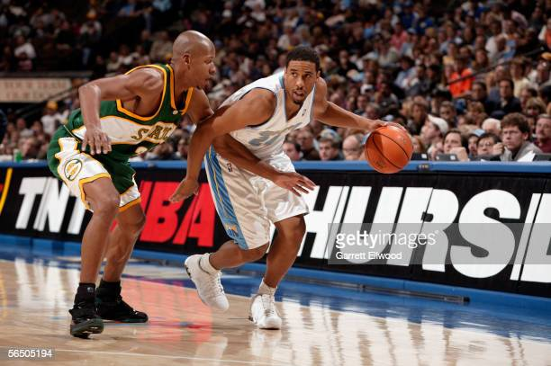 Andre Miller of the Denver Nuggets drives against Ray Allen of the Seattle Sonics on December 29 2005 at the Pepsi Center in Denver Colorado NOTE TO...
