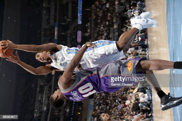 Andre Miller of the Denver Nuggets goes to the basket against Kurt Thomas of the Phoenix Suns on January 10 2006 at the Pepsi Center in Denver...