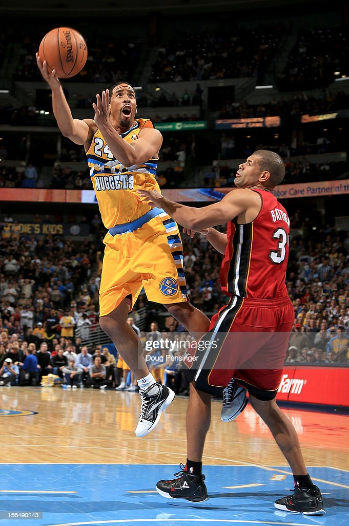 Andre Miller #24 of the Denver Nuggets takes a shot against Shane Battier #31 of the Miami Heat at the Pepsi Center on November 15, 2012 in Denver, Colorado. The Heat defeated the Nuggets 98-93.