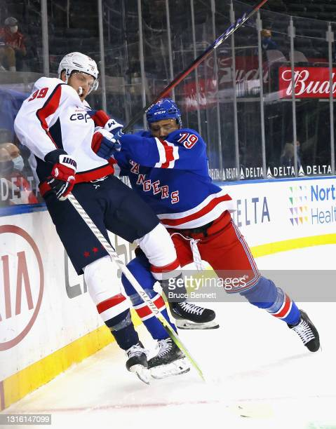 Andre Miller of the New York Rangers checks Anthony Mantha of the Washington Capitals during the first period at Madison Square Garden on May 03,...