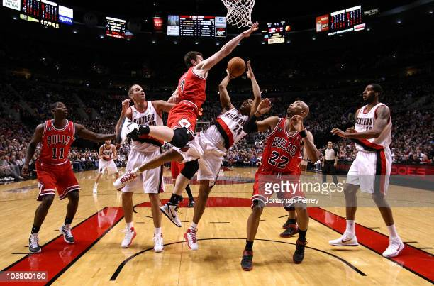 Andre Miller of the Portland Trail Blazers shoots the ball against Omar Asik and Taj Gibson the Chicago Bulls on February 7 2011 at the Rose Garden...