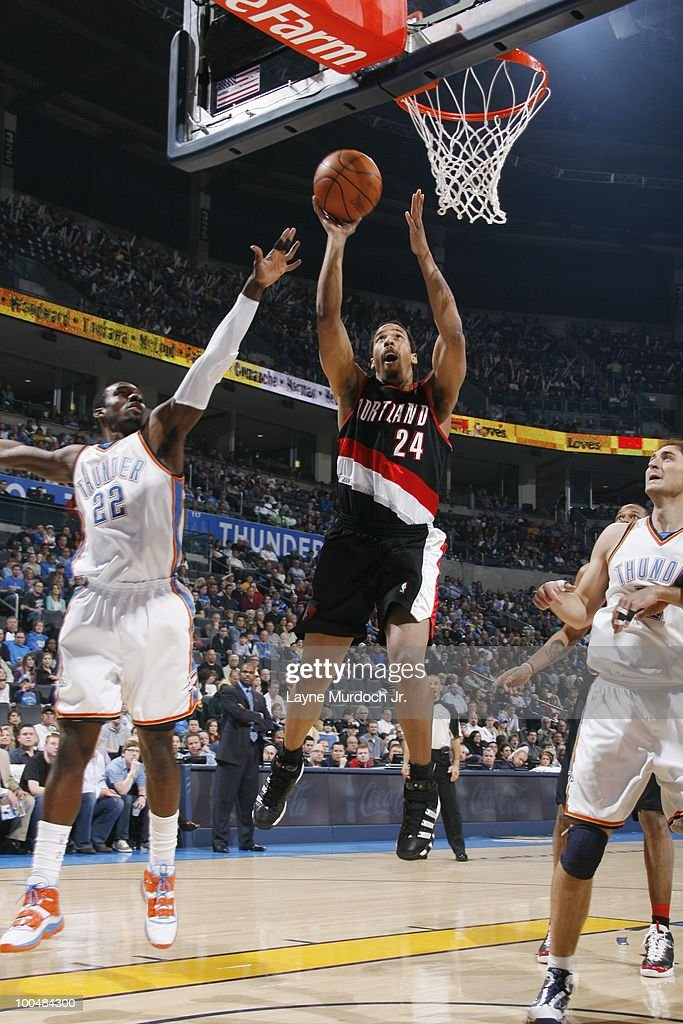 Andre Miller #24 of the Portland Trailblazers goes to the basket against Jeff Green #22 and Nenad Krstic #12 of the Oklahoma City Thunder on March 28, 2010 at the Ford Center in Oklahoma City, Oklahoma.
