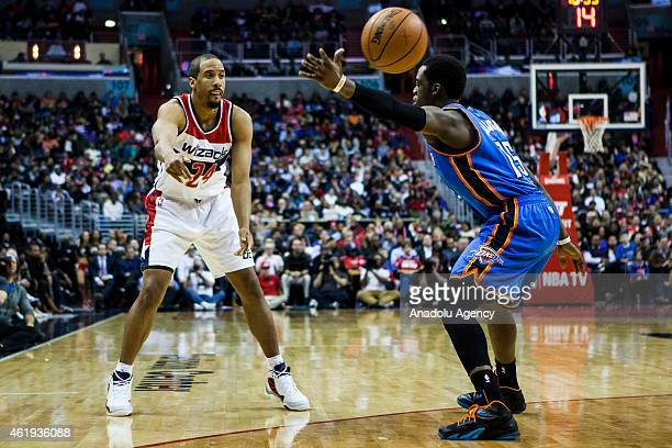 Andre Miller of Washington Wizard in action against Reggie Jackson of Oklahoma City Thunders during an NBA game at the Verizon Center in Washington...