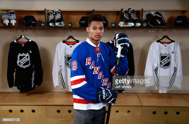 Andre Miller poses for a portrait after being selected twentysecond overall by the New York Rangers during the first round of the 2018 NHL Draft at...