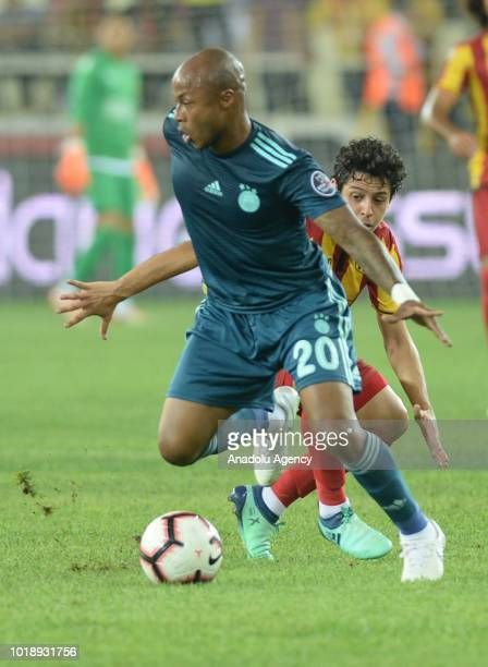 Andre Morgan Rami Ayew of Fenerbahce in action against Guilherme Costa Marques of Evkur Yeni Malatyaspor during the Turkish Super Lig soccer match...