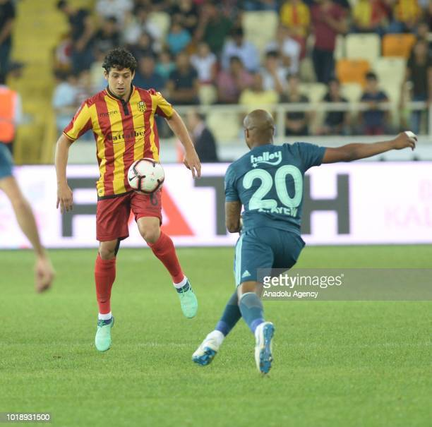 Andre Morgan Rami Ayew of Fenerbahce in action against Guilherme Costa Marques during the Turkish Super Lig soccer match betweenEvkur Yeni...